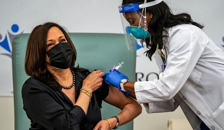Kamala Harris being vaccinated